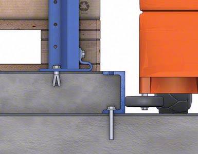 O espaço entre as guias de dois corredores é preenchido com concreto, formando uma ilha sobre a qual se assentam as estantes.